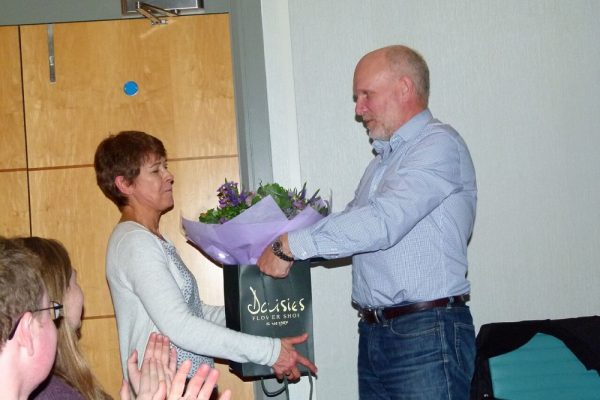 Theresa Howe accepts flowers from Peter Shepherd.